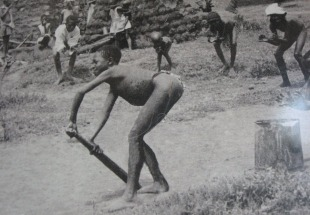 A picture of children playing cricket in South Africa in 1934