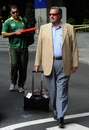 Pakistan team manager Yawar Saeed and coach Waqar Younis leave the team hotel in London, September 21 2010