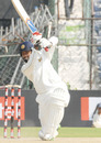 Mumbai captain Wasim Jaffer drives through the off side