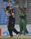 The Bangladesh fielders celebrate the dismissal of Brendan McCullum