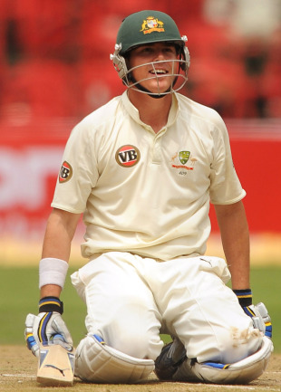 Marcus North sinks to the ground to relish his century, India v Australia, 2nd Test, Bangalore, 2nd day, October 10, 2010