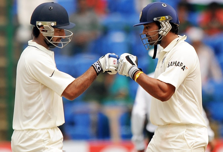 M Vijay and Cheteshwar Pujara punch gloves during their partnership