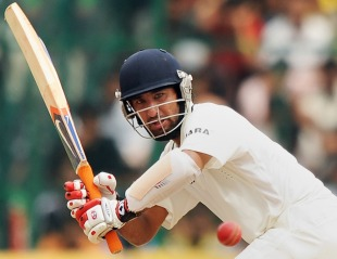 Cheteshwar Pujara plays the ball towards square leg, India v Australia, 2nd Test, Bangalore, 5th day, October 13, 2010