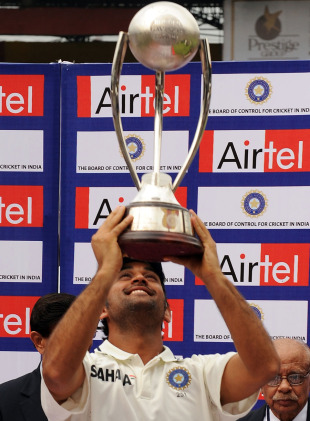 MS Dhoni holds the Border-Gavaskar Trophy aloft, India v Australia, 2nd Test, Bangalore, 5th day, October 13, 2010