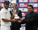 MS Dhoni receives the Border-Gavasakar Trophy from Sunil Gavaskar