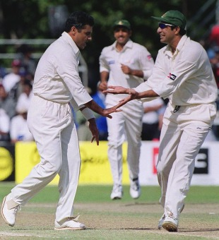 Wasim Akram celebrates with Waqar Younis, Pakistan v West Indies, Toronto, September 1999
