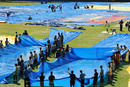 Groundstaff trying to dry the outfield a day ahead of the first ODI, Kochi, October 16, 2010