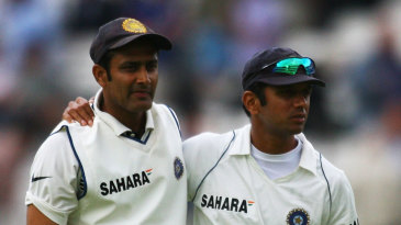 Anil Kumble and Rahul Dravid walk at the end of the day
