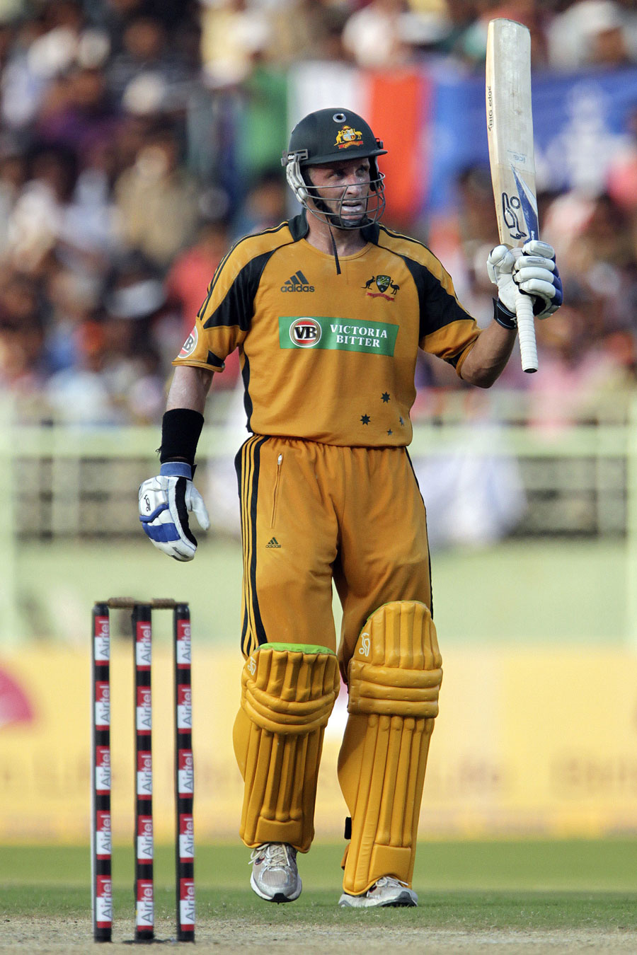 Michael Hussey acknowledges the cheers on reaching fifty