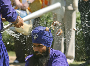 Traditional Sikh martial art experts perform at Anandpur Saheb Gurudwara, near Chandigarh, March 28, 2006