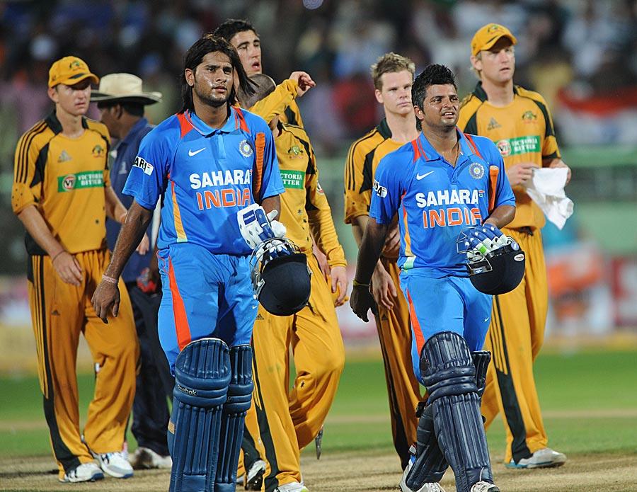 Saurabh Tiwary and Suresh Raina walk off after securing India's win