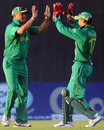 Charl Langeveldt and AB de Villiers celebrate the dismissal of Mohammad Hafeez
