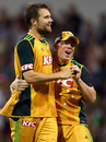 Dirk Nannes and David Warner celebrate the dismissal of Dinesh Chandimal