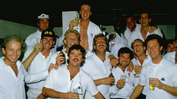 The England squad celebrate after winning the first Ashes Test