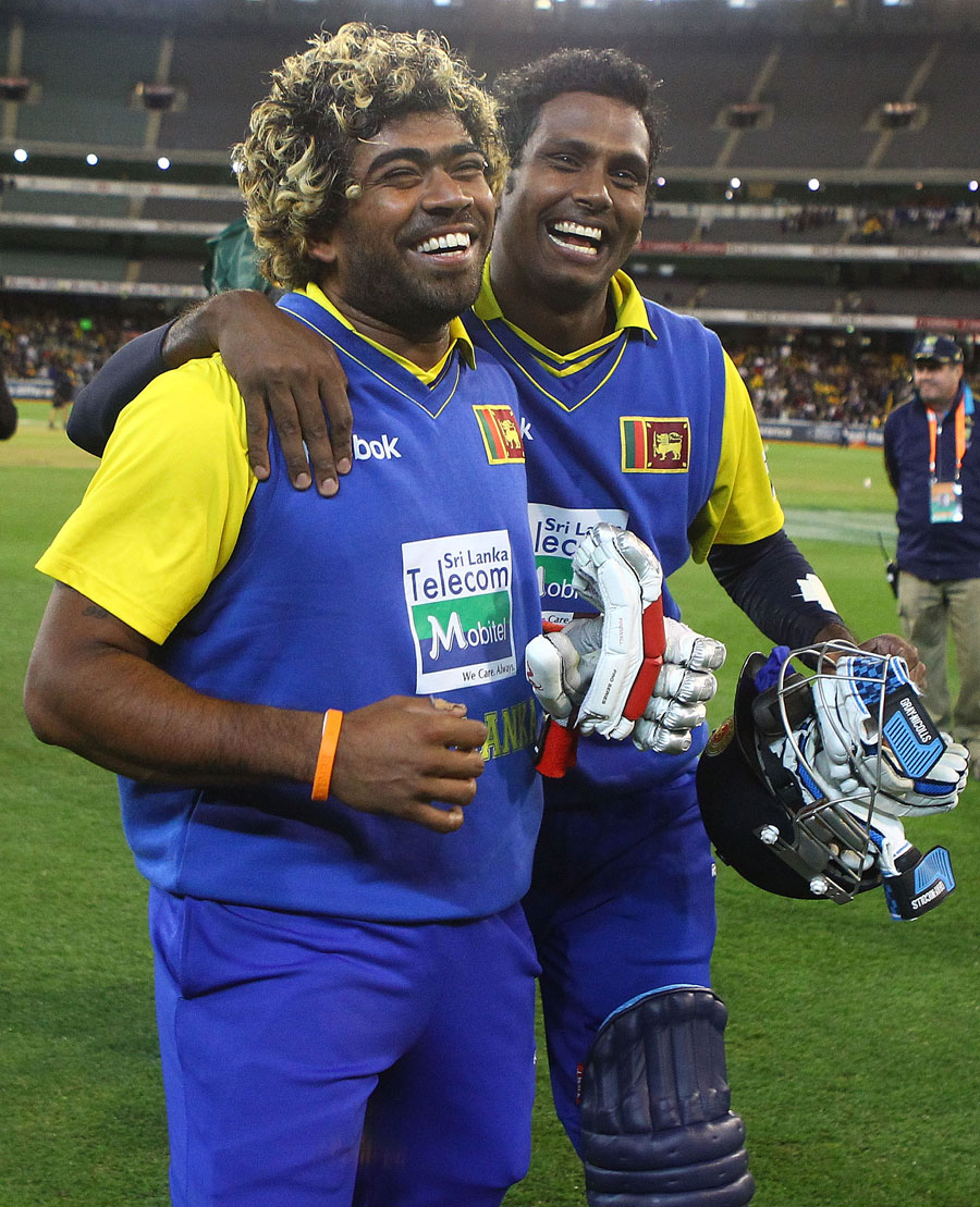 Angelo Mathews and Lasith Malinga smile after Sri Lanka completed the win
