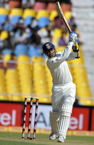 Virender Sehwag launches one straight, India v New Zealand, 1st Test, Ahmedabad, 1st day, November 4, 2010