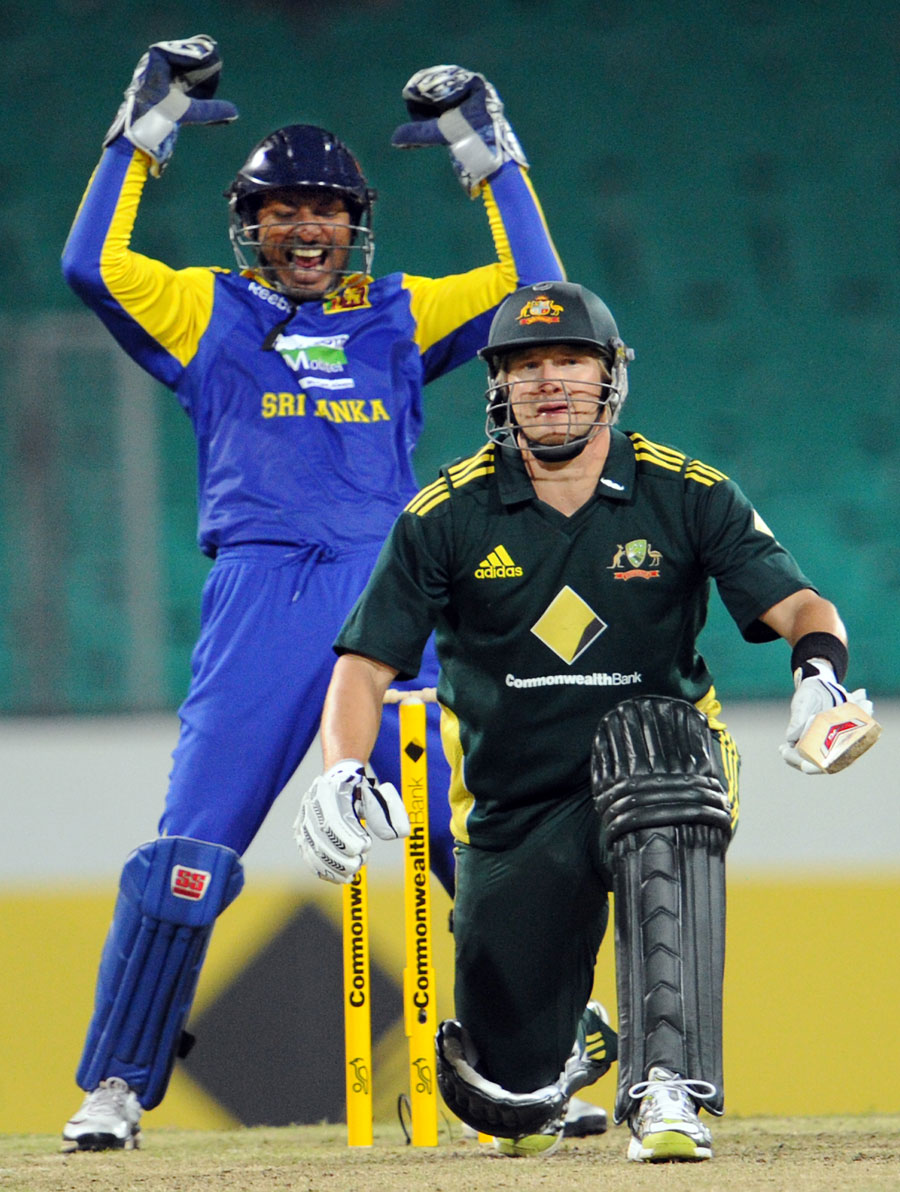 Kumar Sangakkara is delighted after Shane Watson is adjudged leg before