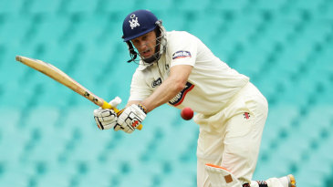David Hussey works the ball on the way to his century