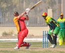 Shakeel Hassan is bowled by Patrick Haines, Germany v Vanuatu, WCL Division 8 Semi-Final, Kuwait City, November 11 2010