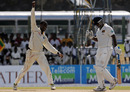 Shane Shillingford celebrates after dismissing Prasanna Jayawardene