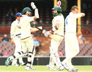 Luke Butterworth and Adam Maher celebrate their win in front of Doug Bollinger, New South Wales v Tasmania, Sydney, 3rd day, 19 November 2010
