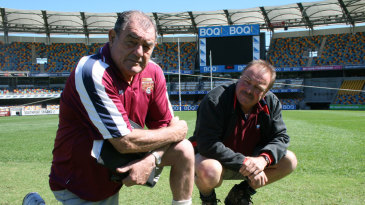 Kevin Mitchell snr and Kevin Mitchell jnr in the middle of the Gabba
