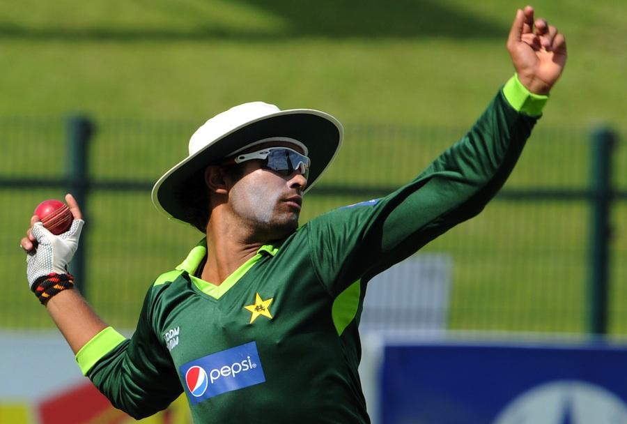 Umar Akmal prepares to throw the ball