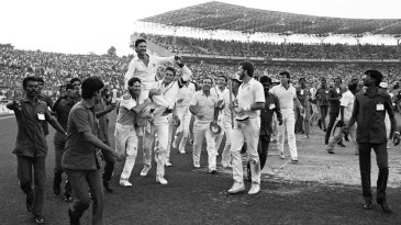 Dean Jones and Tom Moody lift Allan Border onto their shoulders as Australia take a victory lap