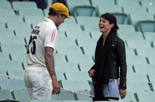 Mitchell Johnson chats with his girlfriend Jessica Bratich, Victoria v Western Australia, Sheffield Shield, MCG, November 20, 2010