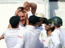 Paul Harris is mobbed by his team-mates after dismissing Younis Khan