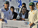 Misbah-ul-haq and Jacques Kallis share the winners cheque after drawing the series, Pakistan v South Africa, 2nd Test, Abu Dhabi, 5th day, November 24, 2010