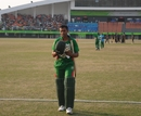 Faisal Hossain, Bangladesh's top scorer, leaves the field after being dismissed for 33, Bangladesh v Sri Lanka, Asia Games, Guangzhou, November 25, 2010