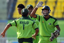 Wicketkeeper Sheharyar Ghani and Khalid Latif are delighted after a Sri Lanka run-out, Pakistan v Sri Lanka, 3rd place play-off, Asian Games, Guangzhou, November 26, 2010
