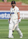 Wellington's Cameron Merchant walks back after his dismissal