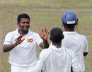 Rangana Herath celebrates his second wicket of the fifth morning