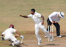 Rangana Herath tries to stop a shot from Carlton Baugh
