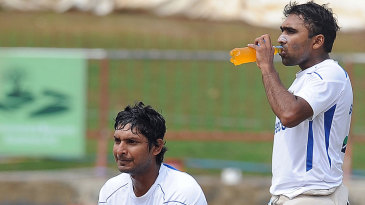 Kumar Sangakkara and Mahela Jayawardene catch a breather during training