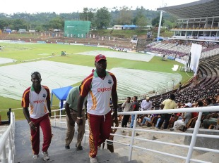 Ottis Gibson and Darren Sammy return indoors on a rainy morning, Sri Lanka v West Indies, 3rd Test, Pallekele, 1st day, December 1, 2010