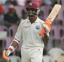 Shivnarine Chanderpaul celebrates after reaching his half-century