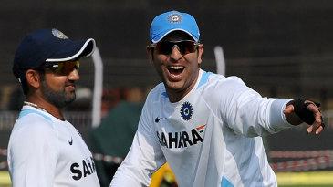 Gautam Gambhir and Yuvraj Singh share a joke, in training