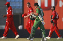 Shakib Al Hasan walks off with the Zimbabwe players after Bangladesh's six-wicket win, Bangladesh v Zimbabwe, 2nd ODI, Mirpur, December 3, 2010