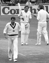 Dennis Lillee walks back to his mark as Ian Both reaches his fifty