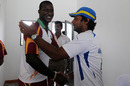 Darren Sammy and Kumar Sangakkara after the final day of the third Test was called off due to rain