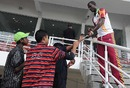Darren Sammy signs autographs for fans