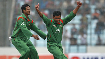 Shakib Al Hasan and Abdur Razzak celebrate one of Razzak's four wickets