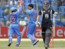 Ashish Nehra and Parthiv Patel celebrate Jamie How's wicket