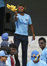 Lasith Malinga passes a bunch of bananas after Sri Lanka's training session was canceled, Hambantota, December 8, 2010
