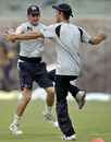 Kane Williamson and Grant Elliott warm up during training
