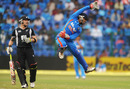 Brendon McCullum watches Parthiv Patel leap in the air to make a stop, India v New Zealand, 4th ODI, Bangalore, December 7, 2010