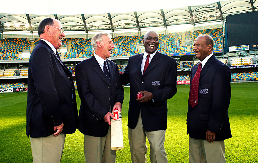 Meckiff (far left) with Lindsay Kline, Wes Hall and Joe Solomon - the four protagonists at the climax of the tied Test - during a reunion at the Gabba in 2000